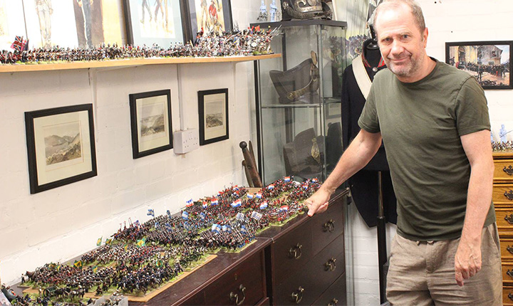 Alan Perry preparing a game table focused on the Triple Alliance War.